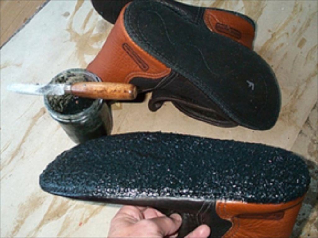 applying goop to leather moccasins soles