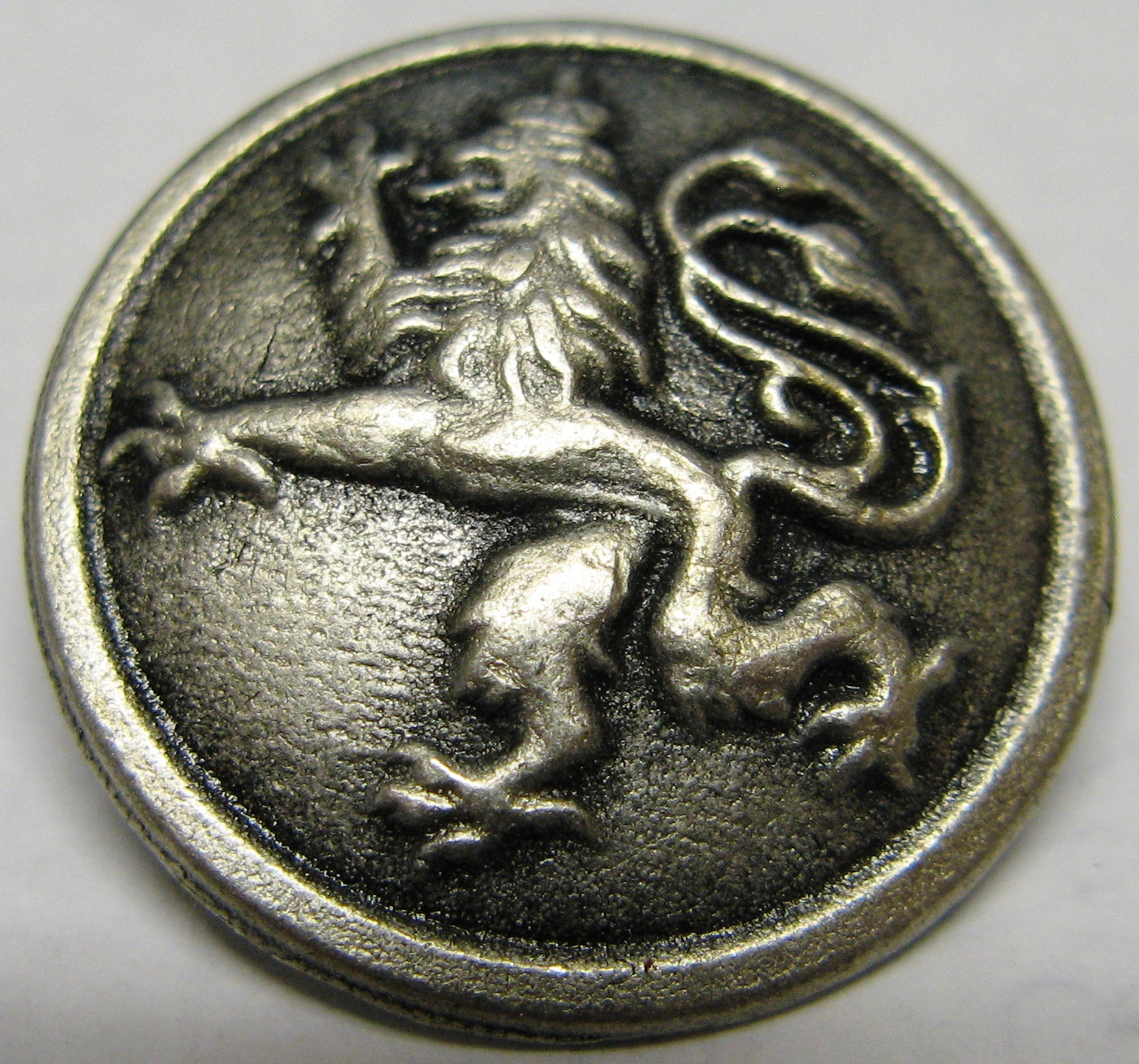 silver metal griffin button