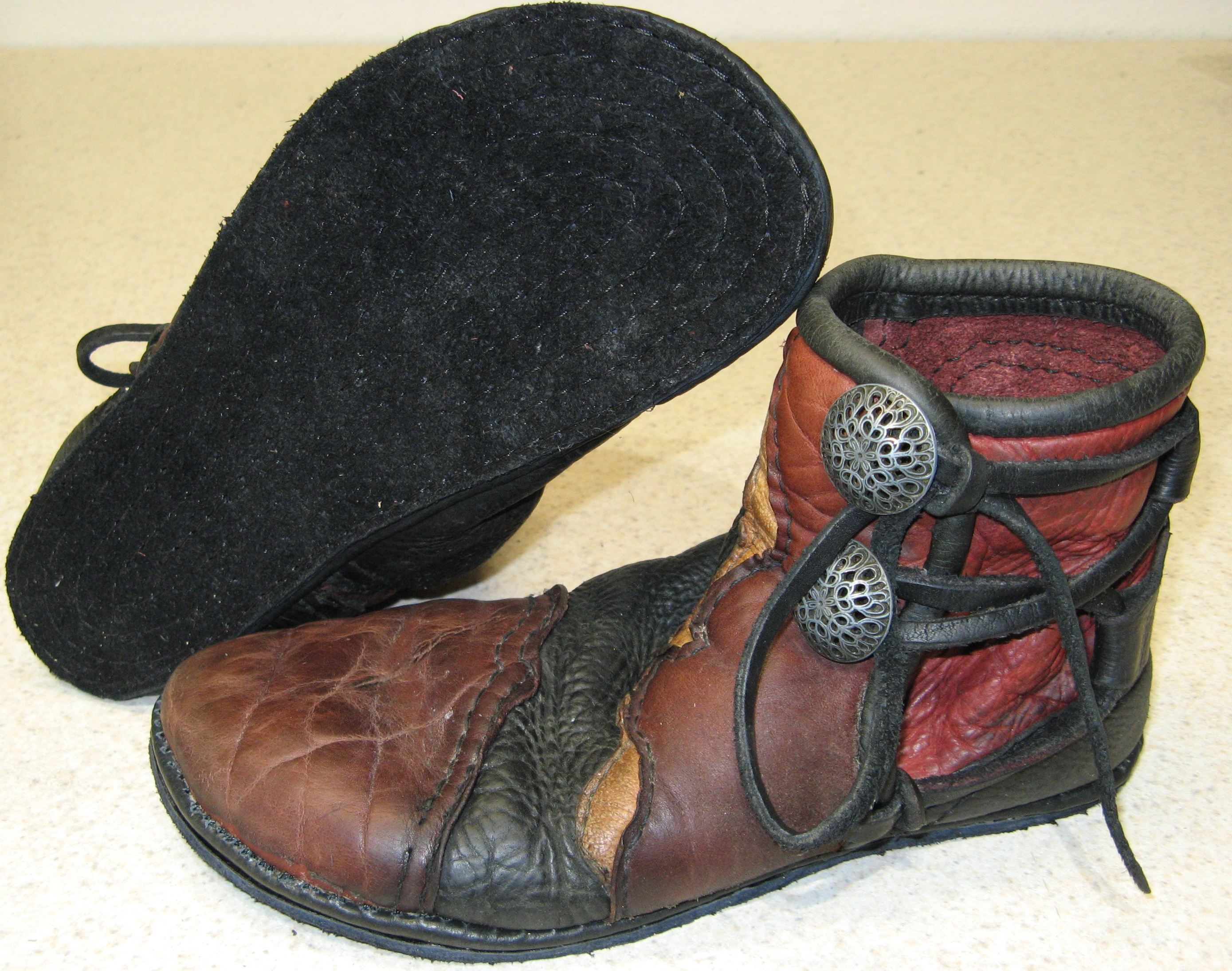 repaired leather moccasins soles