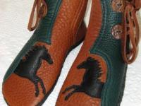 black horse on moccasins